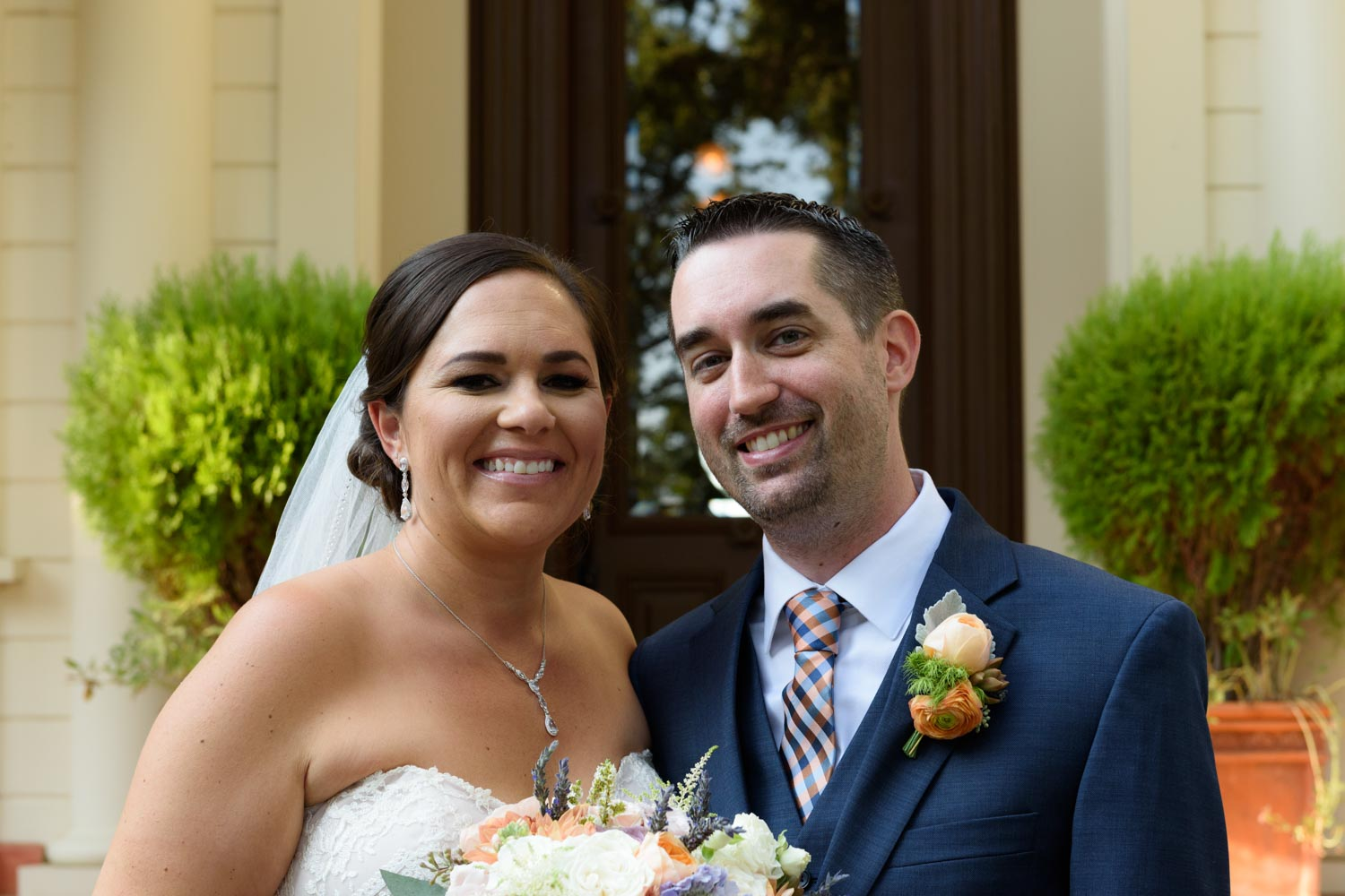 Closeup of smiling bride and groom
