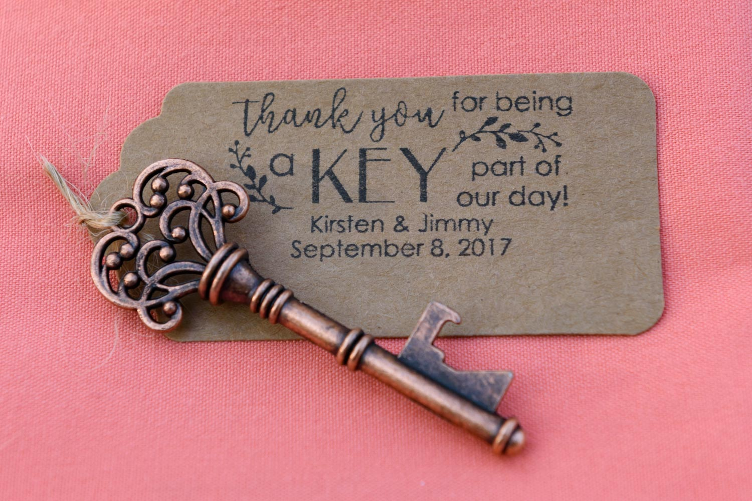 """Antigue key wedding favor tied to """"thank you"""" note"""