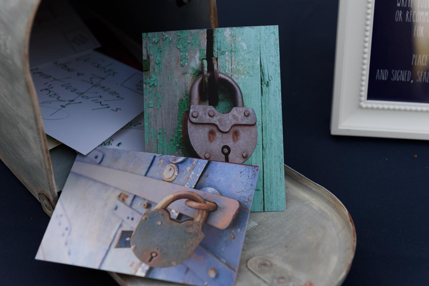 Open mail box, with key-themed postcards spilling out