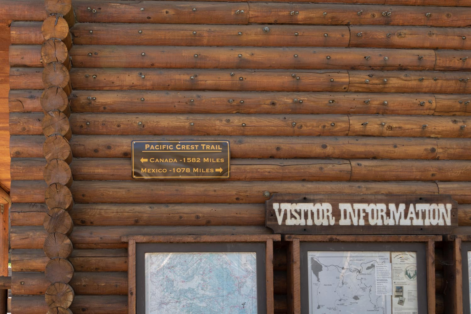 Pacific Crest Trail information plaque, posted on wooden wall of Visitor Center at Carson Pass, California.