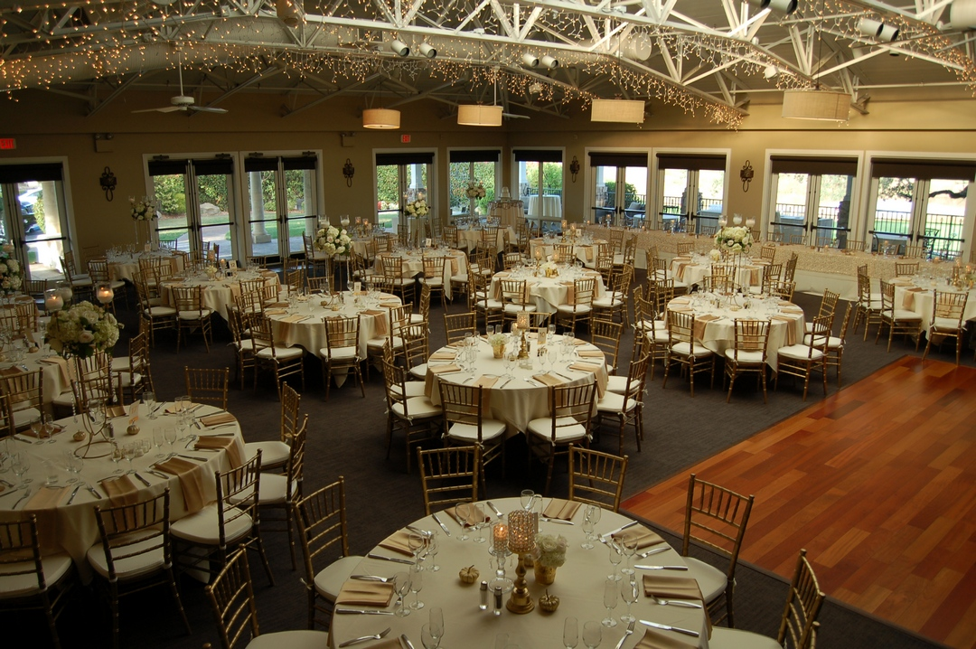 Tables and chairs inside Granite Bay Golf Club ballroom, decorated and ready for wedding reception.