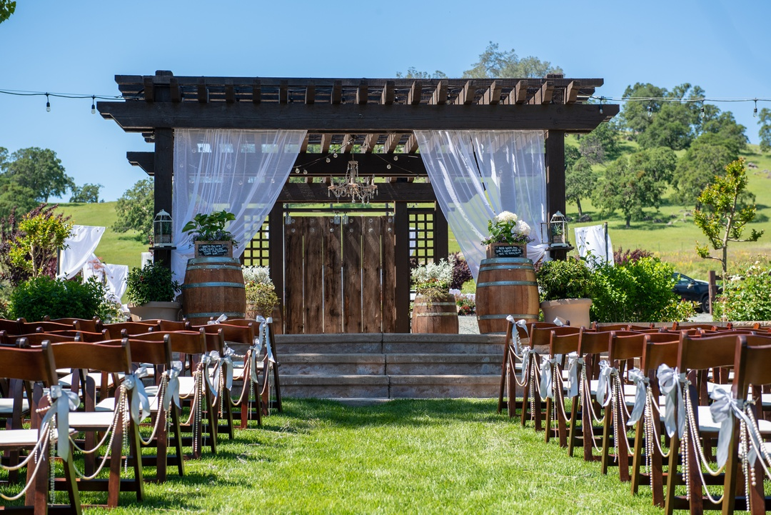 Rustic wedding ceremony site at Rancho Victoria Vineyards, Plymouth, California