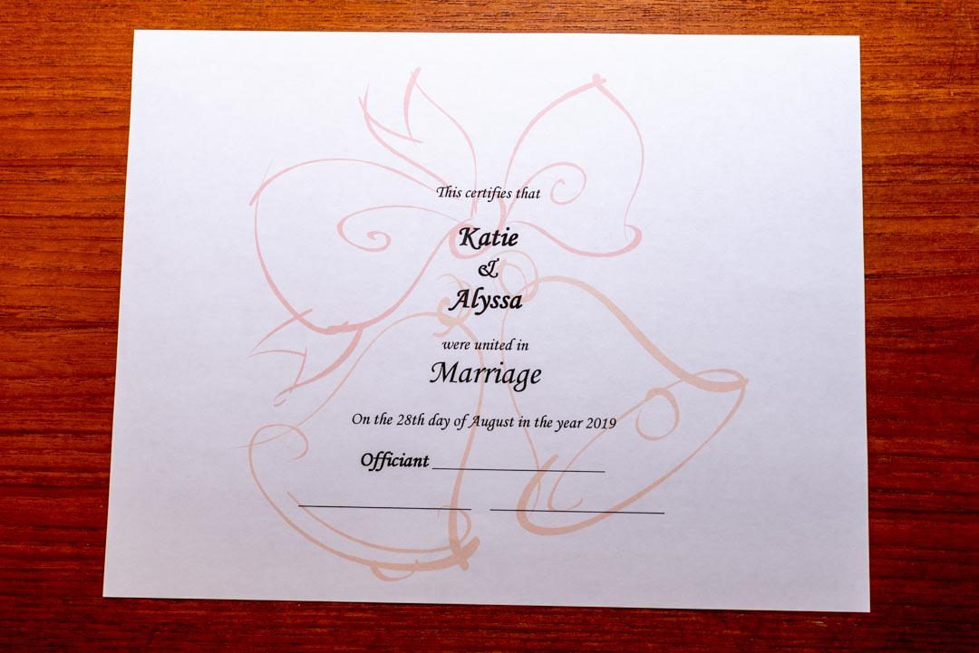 Keepsake Marriage Certificate, listing the couple's name and wedding date, with lines for signature by the Officiant and two witnesses.