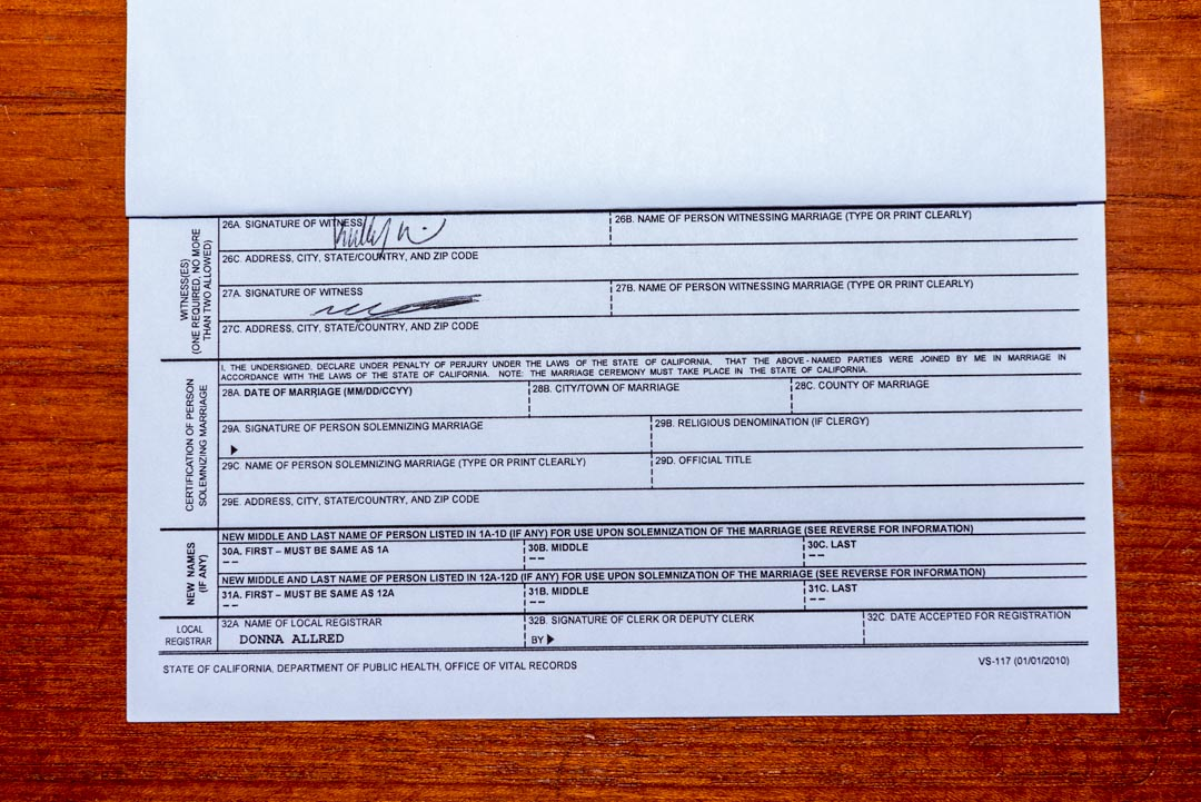 Redacted California Marriage License form, showing two witness signatures.