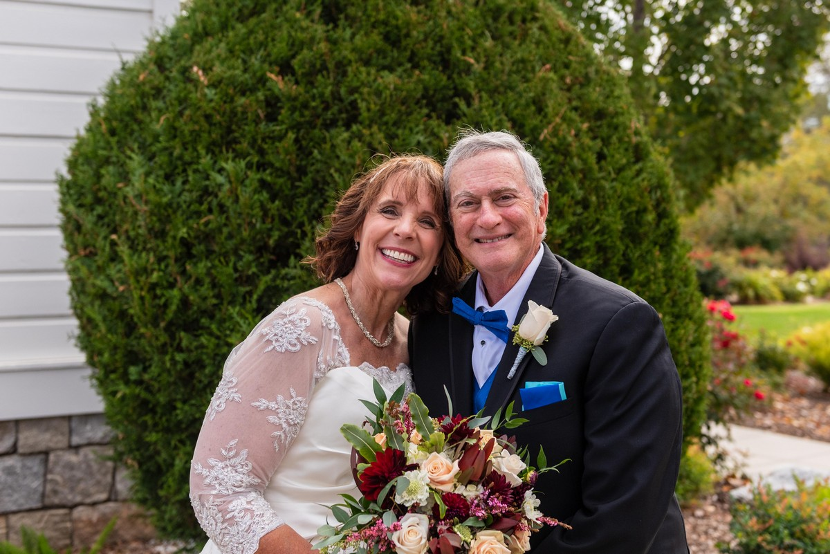 """""""Mature"""" bride and groom, smiling for photos after their wedding ceremony at Old St. Mary's Chapel in Rocklin, California."""
